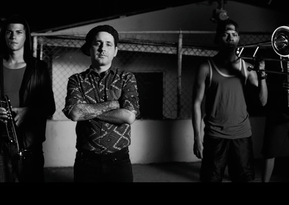 CALLE 13 Confronts The Guns, Violence & Materialism of Hip Hop Fame With Vi